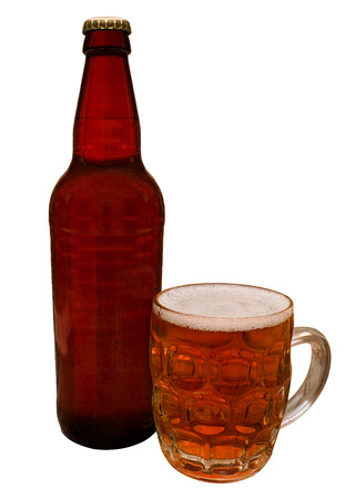 Traditional Craft beer bottle with taster half pint glass containing the real ale ready for drinking in a bar by the connoisseur