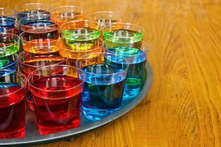 shooter drink: Drinks promotion with various shots on a tray to test as samplers or tasters for merchandising in the drinks industry.