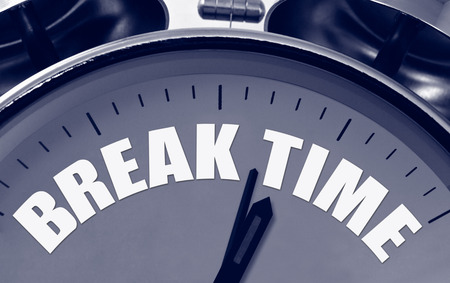 Break Time on a clock face great concept for short breaks during a busy schedule or presentation. Stock Photo
