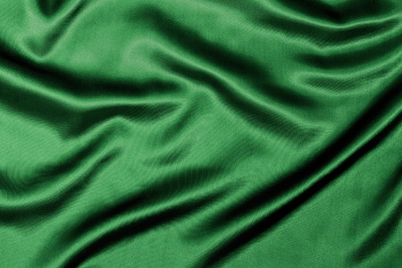 silken: Green Silk background texture with wavy ripples to enhance the sheen of the fabric.