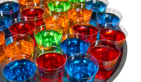 Various alcoholic shots in shot glasses in a serving tray often used for offers in the drinks industry
