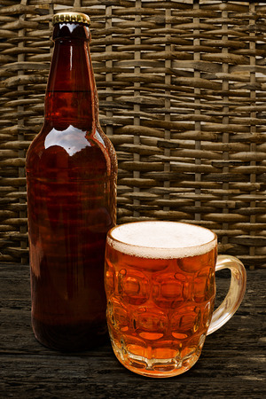 Traditional Craft beer bottle with taster half pint glass of craf beer photo