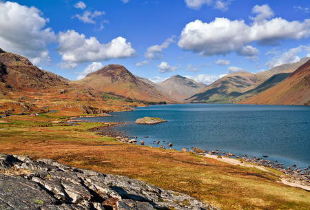 deepest: Wastwater, englands deepest lake located in the English Lake District, a scenic panoramic view showing the view towards the foot of scafell pike englands highest mountain in the distance. Stock Photo