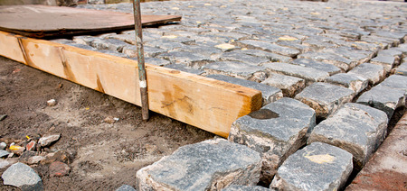 Traditional Cobble stone paving being layed by building contactor