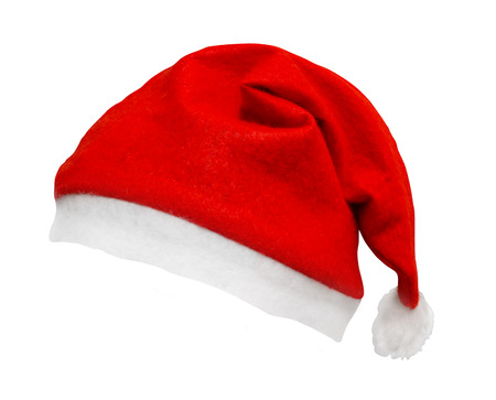 Christmas Santa hat isolated against a white background tilted and on an angle a great element with smooth edges for easy selection and dropping on your design to add a bit of festive spirit.