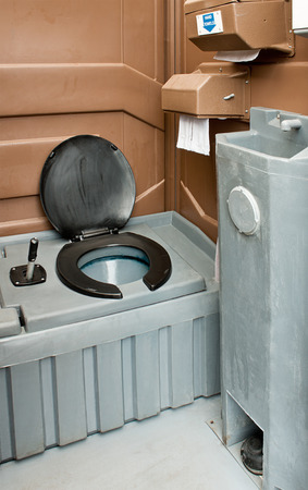 septic tank: The inside of a clean portaloo often hired to be used at festivals and building sites.
