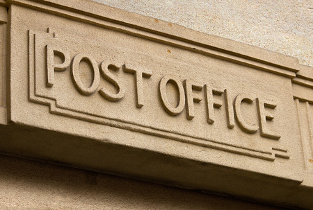 Post Office Building entrance carved in stone above the door of the postal service