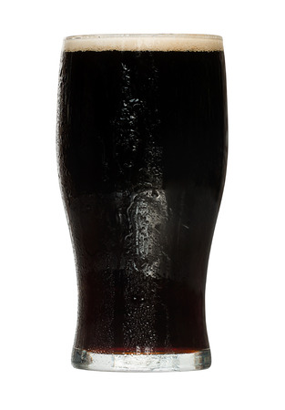 chilled out: Glass of stout a popular alcoholic drink served in irish bars and a traditional refreshment enjoyed on st patricks day in eire. Stock Photo