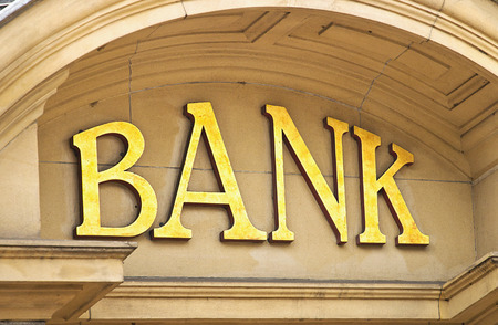 building sector: Gold Bank sign at the entrance to a Banking institute in the centre of the financial sector Stock Photo