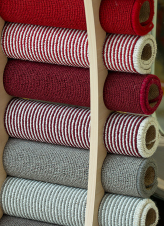 Selection of carpet samples to choose the perfect match for decorating your home interior. Standard-Bild