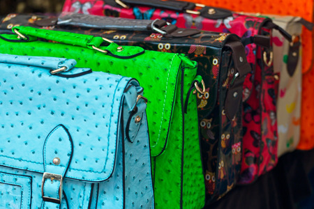Range of colorful handbags for retail sale at a local market stall or smallholders independent shop display.
