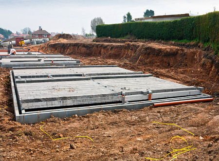 new build: Modern shallow cinder block foundations on a new build construction site for building housing association affordable homes. Stock Photo