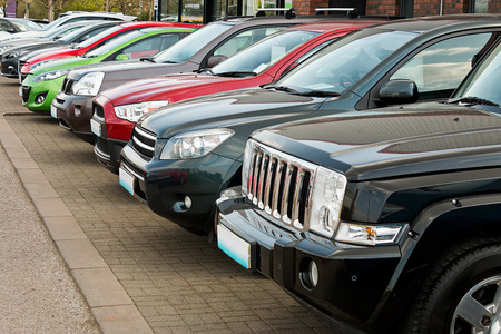 Row of used four by four motorcars also known as 4x4, SUV, off road, utility vehicle, ute or Station wagon arranged for sale on a motor dealers forecourt these types are becoming popular choices to buy as a new family car with off road capability but just