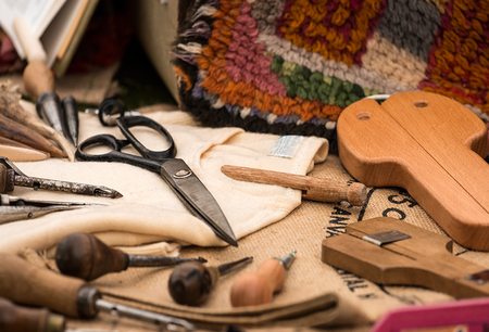 tools: Selection of traditional tools used in the craft of carpet weaving by hand Stock Photo