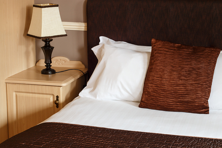 guest house: Bed and breakfast generic room with detail of bed, sheets and bedside cabinet great for any guest house.