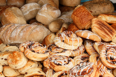 Selection of baked goods available from specialised bakers including buns; scones; pain au chocolate; pain; cobbs and other bread produce. 写真素材
