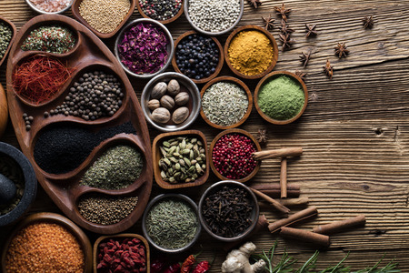 peppercorn: Dry colorful spices in bowls with fresh seasoning on rustic wooden background, top view