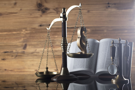 penal system: Law and justice concept - scale and legal code on wooden background Stock Photo
