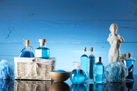 odorous: Spa concept - Venus de Milo statue and bottles with cosmetics on glass table Stock Photo
