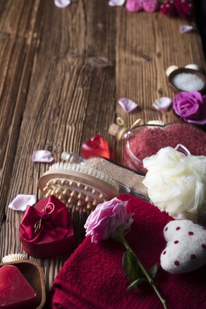 Different hearts and spa accessories on wooden table Stock Photo