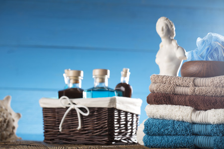 Venus de Milo statue and spa accessories on wooden table