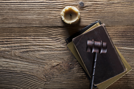 Law and justice theme. Mallet of judge. Legal code. Wooden table. Stock Photo