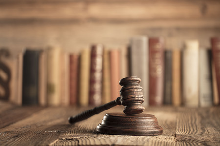 Law and justice theme. Mallet of judge. Legal code. Wooden table. Archivio Fotografico