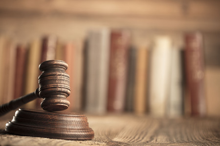 up code: Law and justice theme. Mallet of judge. Legal code. Wooden table. Stock Photo