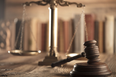up code: Law and justice theme. Mallet of judge and scale of justice. Legal code. Wooden table.