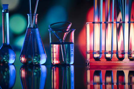 Laboratory theme.  Laboratory experiment. Test tubes. Scietific lab concept. Colorful bokeh.
