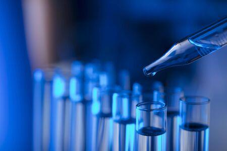 Laboratory theme.  Laboratory experiment. Test tubes. Scietific lab concept. Blue background.