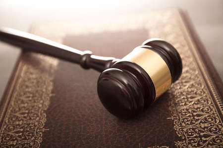 golden rule: Legal system concept. Mallet of the judge and legal code as symbols of legal system.