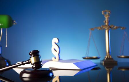 Lawyer, counselor office. Consultation with a lawyer concept. Gavel of the jugde and scale of justice on glass table and blue background.  7 Archivio Fotografico
