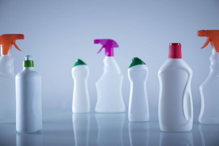 Spring cleanup theme. Variety of  house cleaning products on white table and background. Banque d'images