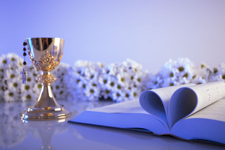 tabernacle: First Holy Communion. Catholic religion theme. Crucifix, Bible, bread isolated on white table and white background.