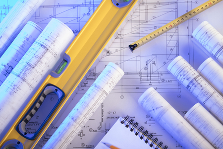 Contractor concept. Construction blueprints with tools, top view. Banque d'images