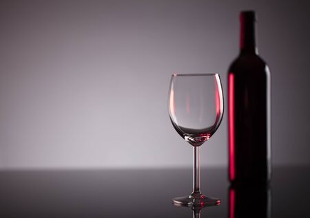 degustation: Glass of red wine on the  shiny table. Stock Photo