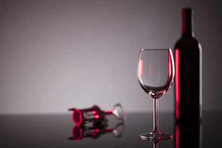 Glass of red wine on the  shiny table. Stock Photo