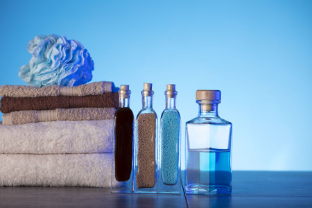 Spa and wellness products on the blue background. Фото со стока