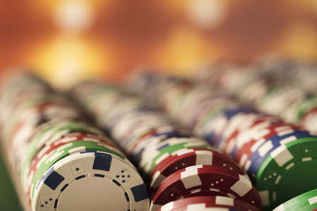 Casino concept. Stacks of poker chips. Colorful bokeh.
