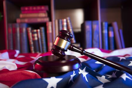 American law concept. Gavel of the judge and american flag