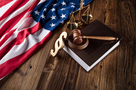 American law concept. Gavel of the judge and american flag.