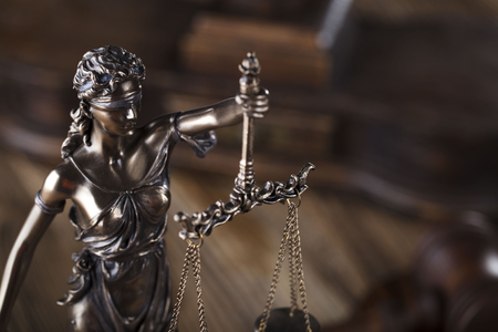 punishing: Justice concept. Gavel of the judge. Lady justice. Scale. Wooden table.