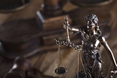 defendant: Justice concept. Gavel of the judge. Lady justice. Scale. Wooden table.