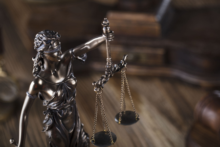 Justice concept. Gavel of the judge. Lady justice. Scale. Wooden table.