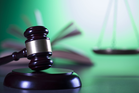 barrister: Law symbols, gavel, scale, books, Themis.  Law concept background. Place for text.