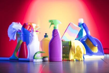 Variety of  house cleaning products on a colorful background.