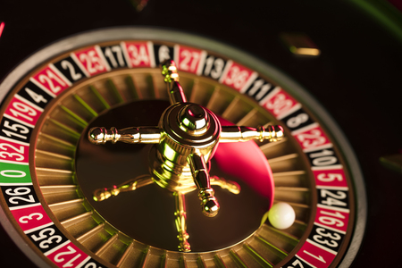 Casino theme. Gambling games. Closeup of the roulette wheel. Reklamní fotografie - 83573293