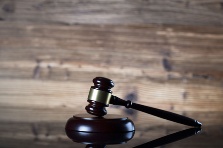 Auction and business concept.  Gavel on the wooden background.