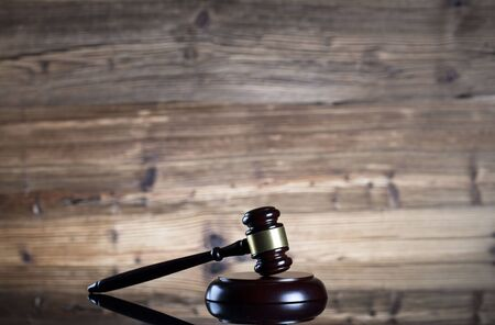 compulsory: Auction and business concept.  Gavel on the wooden background.